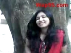 Indian college couple kiss outdoor
