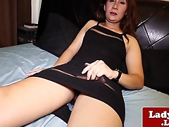 Dressed asian shemale jerking her cock